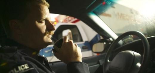 Police Officer talks on car radio