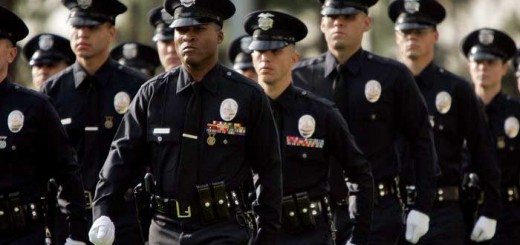 Uniformed Police Officers marching in formation